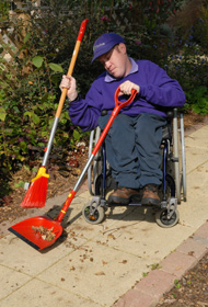 Sweeping with long handled dustpan and brush