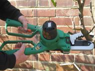 Powered safety pruning saw and lopper